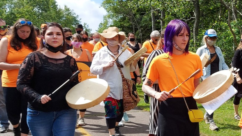 Kateri Hibbert and Mykayla Spinney, of Eastern Circle, leading the crowd with drums at a recent Turtle Island Healing Walk in Saint John.