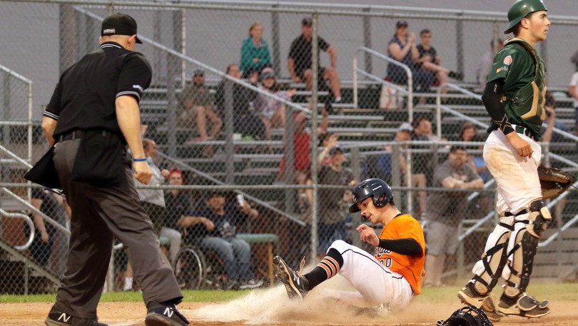 Moncton Fisher Cats' Sam Lund slides home safely against the Charlottetown Islanders during New Brunswick Senior Baseball League regular-season play earlier this summer. The teams clash in the league final, beginning on Sunday.
