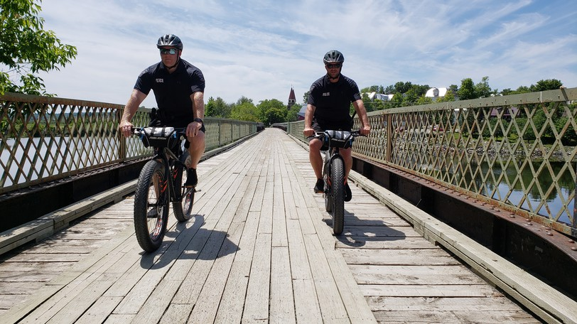 Const. Shaun Kimball, the community resource officer, left, and Const. Corey Porter, member of the crime reduction unit with the Woodstock Police Force, right patrol the Trans canad Trail in Woodstock. Town council passed a motion to replace the concrete barriers on the trail in the community to prevent illegal off-road vehicle usage.