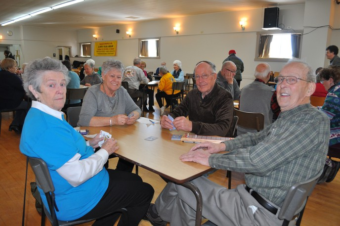 Playing cards is always a popular part of the Western Valley Forever Young Friendship Games, formerly the Western Valley Senior InMotion Games. From left in this file photo are Eunice Fox of Nackawic, Betty Lockhart of Perth-Andover and Neville Ashworth and Keith Estey of the Plaster Rock team. The games have been postponed due to rising COVID-19 cases in the valley.
