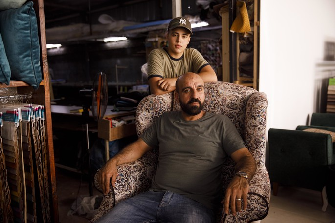 A portrait of Mahmoud Akhrass and his son Yamen Akhrass in his furniture shop in Kufr Aqab near Ramallah, West Bank on July 14, 2021.