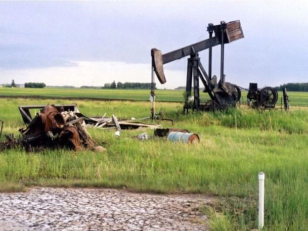 Abandoned oil well equipment sits on a farm near Legal, Alta.