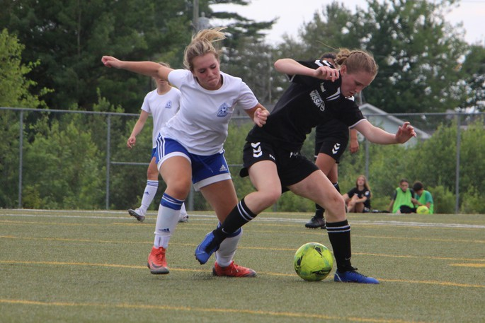 Kelsey Holland, of the FDSA's Fredericton Nissan U17 Premiership girls (dark jersey), fights for possession of the ball in this photo. The various provincial Premiership championships will be determined this weekend in Fredericton.