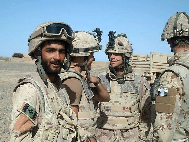 Undated photo of an interpreter with Canadian soldiers in Afghanistan.