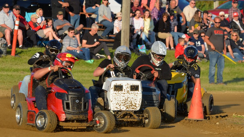 Lawnmower racers face off during a heat at the Connell Park Raceway as part of Old Home Week's lawnmower races on July 31. Town council discussed how they can combat climate change while keeping community favourites like the lawnmower races.
