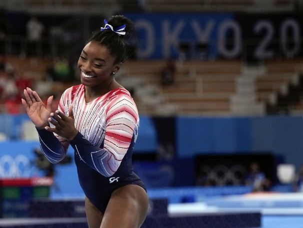 Gymnast Simone Biles of Team United States smiles after competing in the Tokyo 2020 Olympic Games Women's Gymnastics Balance Beam Final on Tuesday, Aug. 3.