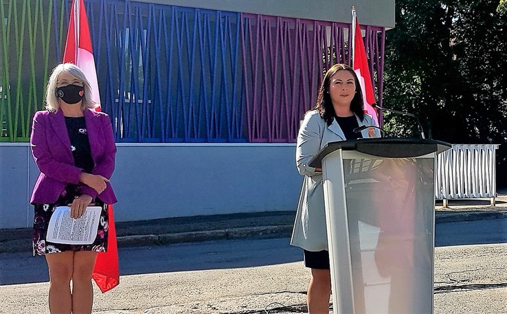 Fredericton MP Jenica Atwin announced earlier this summer outside Clinic 554 that the federal government will provide $366,000 in research funding to the University of New Brunswick to study how surgical abortions are accessed in the province. To Atwin's left is federal Health Minister Patty Hajdu.