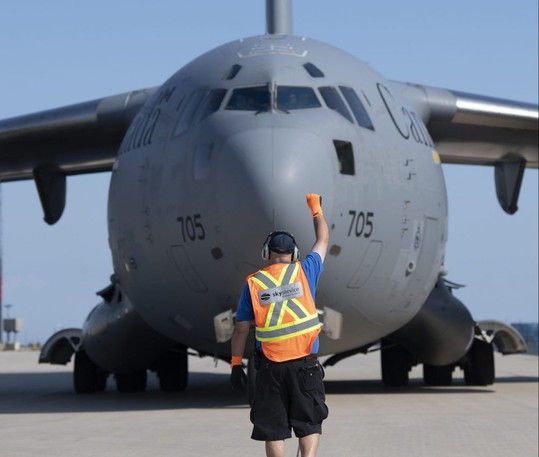 Royal Canadian Air Force C-17 Globemaster parks after touching down at Toronto Pearson International Airport on Wednesday, evacuating citizens in danger for helping the Canadian military during their mission in Afghanistan.