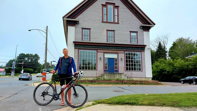 """Radical Edge owner Mike Davis stands at the back of Gibson's Landing in Marysville. Along with business partner Carl Martens, he plans to transform the historic three-storey building into """"a social hub"""" for the area, including a bike shop, beer on tap, fresh-brewed coffee and more."""