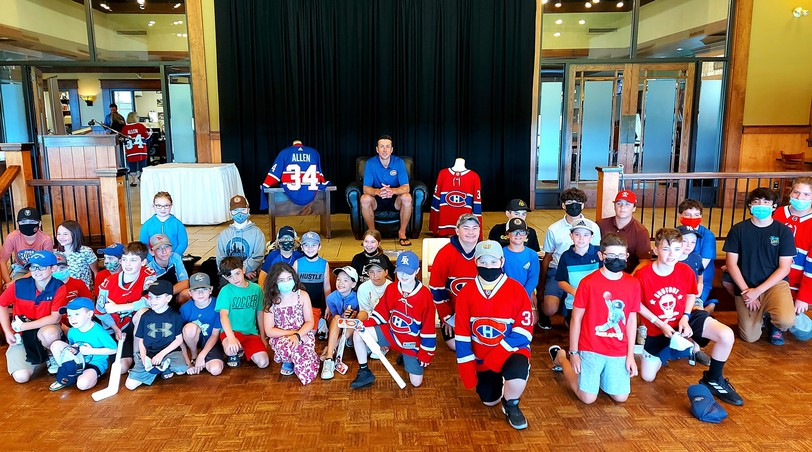 Youths gather for a photo in front of Jake Allen after the Montreal Canadiens goaltender gave an hour-long Q & A at Kingswood Lodge on Aug. 11, a prelude to the fifth Jake Allen Golf Classic, which raised $70,000 - $60,000 to help the Chalmers Foundation restore the outdoor play area in the pediatric ward.