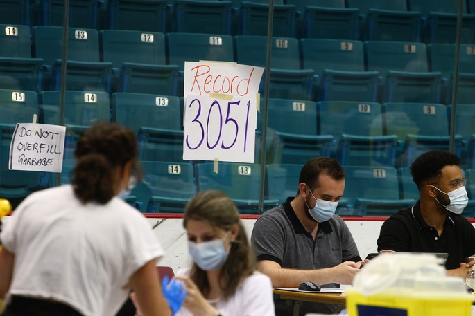 A 'daily record' sign at the Moncton Coliseum vaccination clinic is seen in this file photo. A university student leader said more younger people would get vaccinated if clinics were offered in different locations and at different times of day.