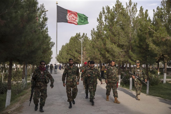 Afghan Army soldiers stroll through a park in Kabul in this file photo. The city has been overrun by the Taliban, who now control almost the entirety of Afghanistan.