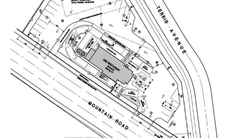 A site plan shows the design of a proposed drive-thru that would be located on a vacant lot at Mountain Road and Terris Avenue in Moncton.