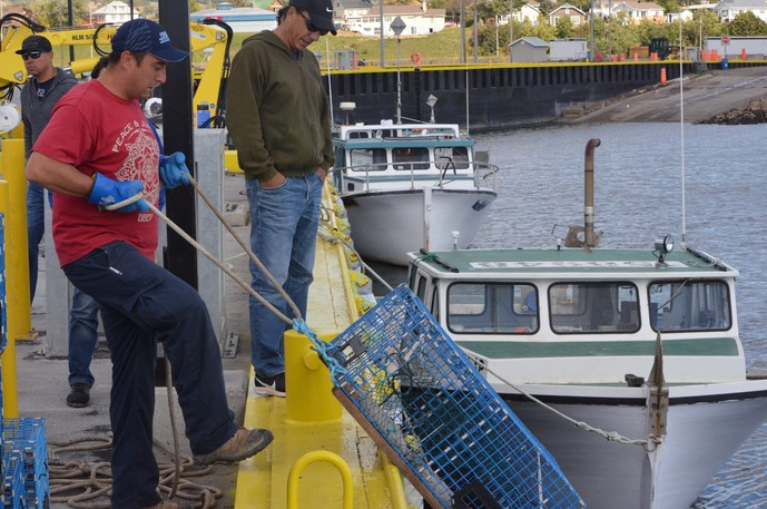 Lobster fishermen from Listuguj First Nation are shown in a file photo. The dispute between the federal government and Indigenous fishers in the Maritime stems from federal overreach, writes Ian Peach.