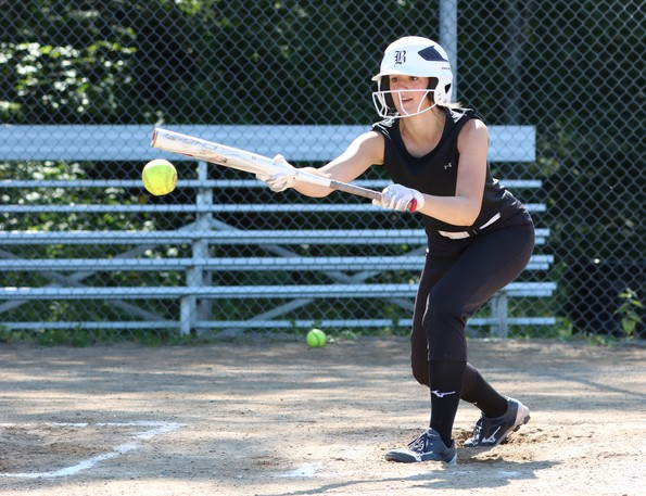 Southern Black Bears U16 softball player Avery Schichilone lines up a bunt during batting practice in preparation for the 2021 U16 Girls Eastern Canadian Championship.