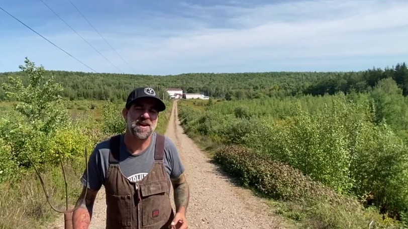 Charles Burrell, founder and president of the Humanity Project, shown in a video announcing the charity's 187-acre farm last year, says new vaccine requirements could diminish the number of volunteers at the downtown Moncton soup kitchen.