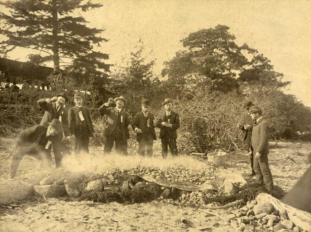 1903 photograph taken at Westfield Beach of men having a clam bake on the beach. The photograph was taken by Isaac Erb.