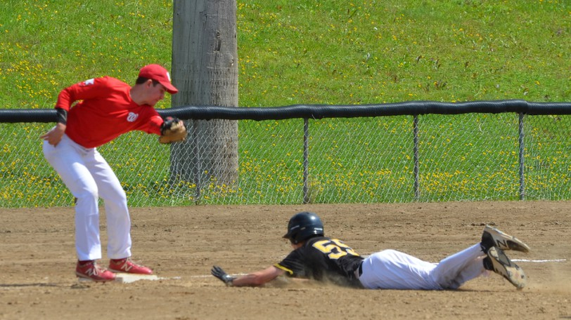 The U18 Shiretowners' Vincent Hebert applies a tag to a Port City Pirates rival sliding head first into third base during the second game in a triple header on Sunday.