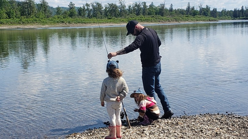 A man and children fishing in New Brunswick. A member of the New Brunswick Wildlife Federation's Fisheries Committee says stocking the province's lakes with sterile brook trout is important to get more people out angling again. Recently the Charlo hatchery obtained funding to improve its operations supplying the province with such fish.