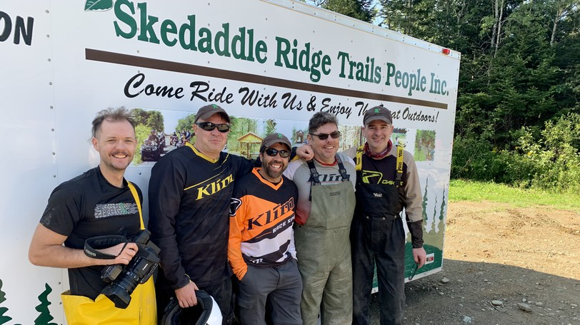 The Trekkit Crew stand in front of the Skedaddle Ridge ATV Club trailer they were provided to transport their ATVs from Benton to Carr Siding. From left are Ben Cummings, videographer; Ryan Groom, producer; Christian Perry, support; Paul Archer, chef and crew; and Rodney McAffee, director of photography.