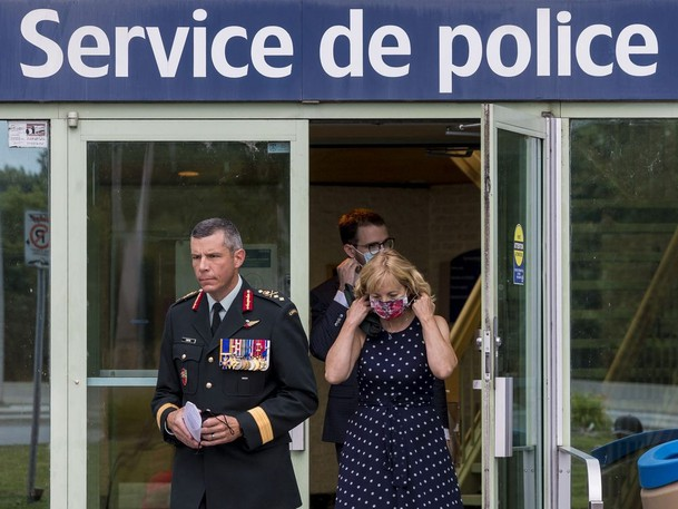 Maj.-Gen. Dany Fortin leaves the Gatineau Police headquarters with his lawyer Phillipe Morneau and his wife Madeleine Collin on Wednesday, Aug. 18, 2021.