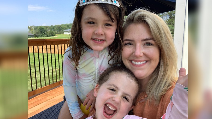 """Brittany Rosborough, shown with four-and-a-half year old Lennon and three-year-old Reagan Allen, is an """"honourary aunt"""" to Jake and Shannon Allen's two daughters. A teacher in Nunavit for most of the year, she returns to New Brunswick each summer and lives with the Allen family for part of the time."""