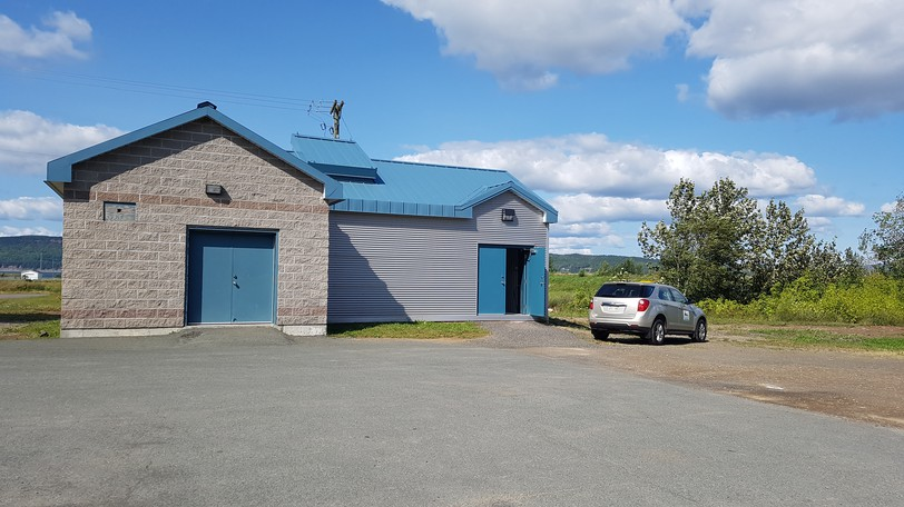 Dalhousie's hydroelectric turbine, powered by flow in the pipe that supplies the town with water, is finally up and running after having been in the works since 2015. It is housed in this building next to the town fire station under which the water pipe passes.