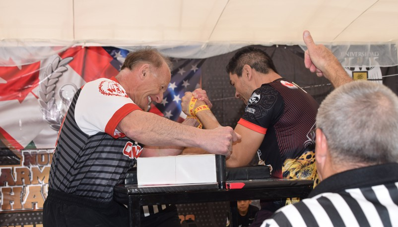 Grande-Digue native Sylvio Bourque, left, competed at the North American arm wrestling championships in Mexico in 2020. Bourque, a Canadian Arm Wrestling Federation Hall of Famer, died on Tuesday at the age of 62.
