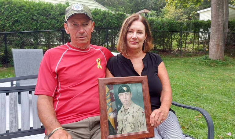 Saint John's Donald and Lauren Greenslade hold a photo of their son, Pte. David Greenslade, who was killed in Afghanistan on Easter Sunday 2007 by a roadside bomb planted by the Taliban.