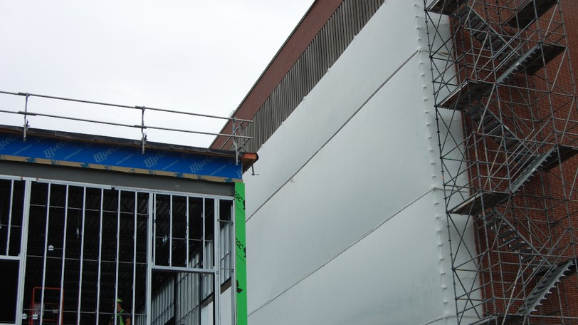 Scaffolding and tarpaulin, pictured Wednesday, covers the north-facing windows of a building on Macbeath Avenue at The Moncton Hospital, where construction of a maternal and newborn expansion is underway.