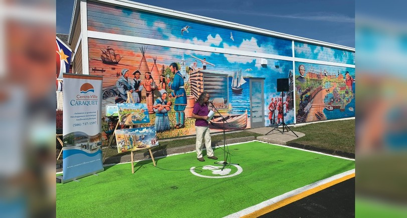 Raynald Basque, a multifaceted artistoriginally from Tracadie but living in Caraquet,is the artist behind the new mural at the tourism bureau in Caraquet. The mural has drawn some criticism for misrepresenting Mi'kmaq people.