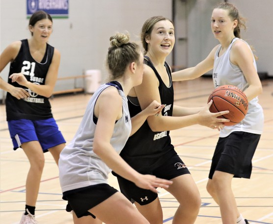 Saint John Surge forward Rheah McFarland (middle with ball) and her teammates have enjoyed their experience with the program.