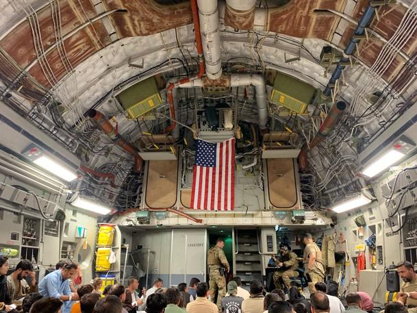 Afghans crowd aboard a U.S. military evacuation flight in Kabul on Aug. 17, 2021.