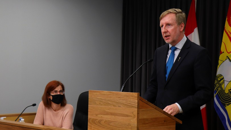 Education Minister Dominic Cardy and the province's deputy chief medical officer of health, Dr. Cristin Muecke, present a back-to-school plan in Fredericton last Friday.