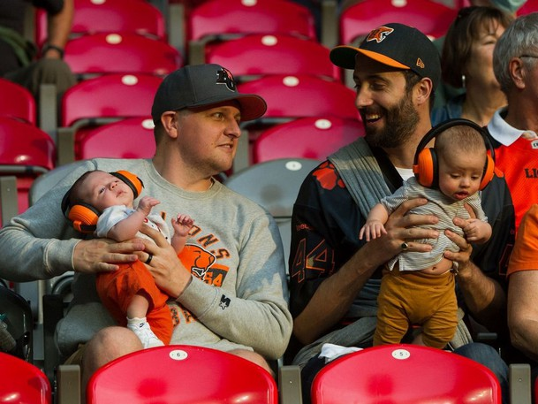 Fans and their babies at BC Lions and Edmonton Elks in CFL action at BC Place in Vancouver on Aug. 19, 2021.
