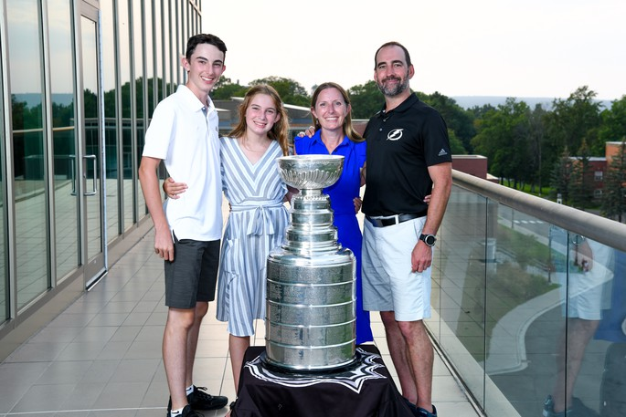 The Hamilton family, from left, 15-year-old Ben, 12-year-old Addison, Karyn Hamilton and Dr. Ryan Hamilton pose with the Stanley Cup at the Richard J. Currie Center on the UNB campus Friday. Hamilton, an associate professor of psychology at the University of New Brunswick, is the mental performance coach with the NHL Stanley Cup champion Tampa Bay Lightning.