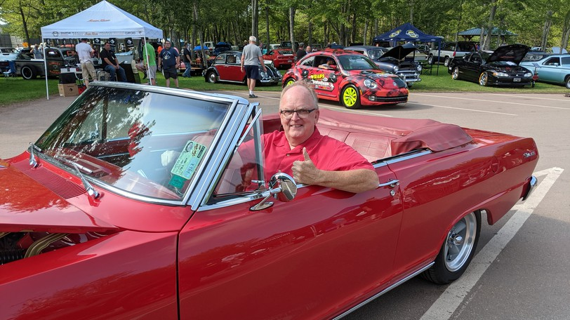 Atlantic Nationals show chairman Bill Doherty sits inside his wife Debbie's 1962 Chevy Nova Saturday morning. This year's event was a scaled down version with about 1,300 vehiclesat Centennial Park instead of the usual 1,700 to 2,100.