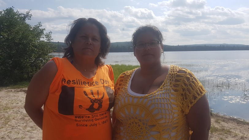 Andrea Polchies and Savanna Perley are two of the Wolastoqiyik women who took to the water to put a stop to a controversial plan to poison the water to eradicate an invasive fish species.