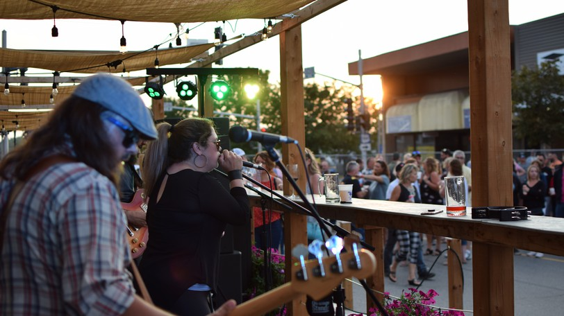 The High Tide Blues Band entertains the crowd at a block party on Main Street hosted by Au Bootlegger Saturday evening.