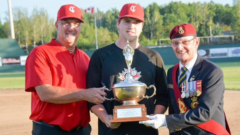 Dylan Dawson, centre, of the Chatham Molson Junior Ironmen accepts the Willie Jardine Memorial Trophy Wednesday at Ironmen Field from junior Ironmen head coach David Hale, left, and Royal Canadian Legion Branch 3 sergeant-at-arms George Springer.