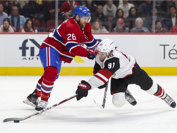 Montreal Canadiens Jeff Petry pushes Arizona Coyotes Taylor Hall to the ice in this archive photo.