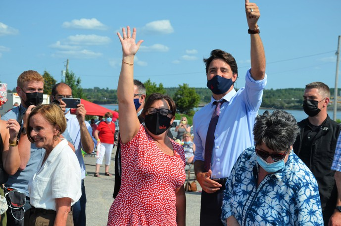 Miramichi-Grand Lake Liberal candidate Lisa Harris, left, and federal Liberal Leader Justin Trudeau wave to supporters Sunday at a rally outside Harris' campaign office.
