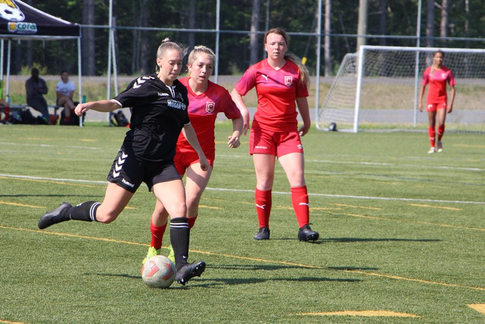 Avery Erb, of the FDSA's Fredericton Nissan U17 Premiership Girls, maneuvers the ball away from a Codiac attacker during Sunday's 2-0 Fredericton win at Scotiabank Park South.