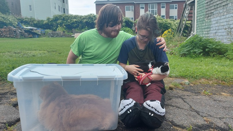 Ryan Rouse and James Arsenault saved their cats Romeo and Tinker as they fled their south end apartment during a fire on Monday morning.