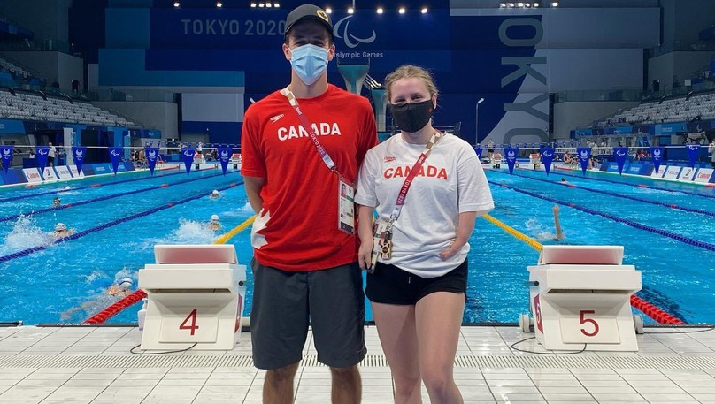 Swimming coach Ryan Allen, left, and swimmer Danielle Dorris, both of Moncton, are participating in the Paralympic Summer Games in Tokyo, Japan.