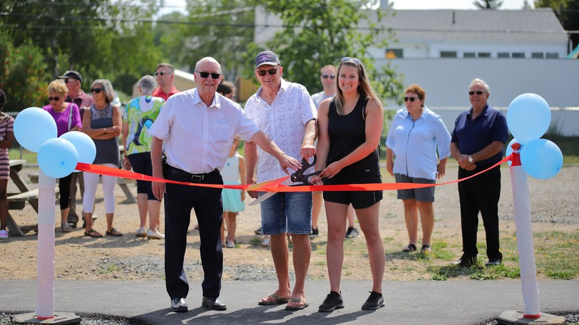 The Town of Beresford celebrated the grand opening of the Edmond Aubé Park in the Foulem subdivision Saturday. Pictured from left: Beresford Mayor Edgar Aubé, Éric Aubé, representative of the Aubé family, and Lyne Boudreau, president of the renovation committee.