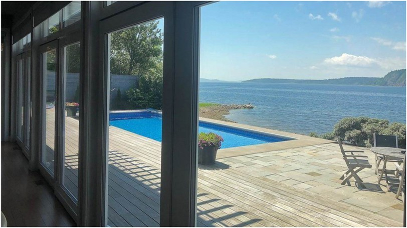 A window wall of glass is one of the many highlights of this luxury home at 57 Maliseet Dr. in Rothesay