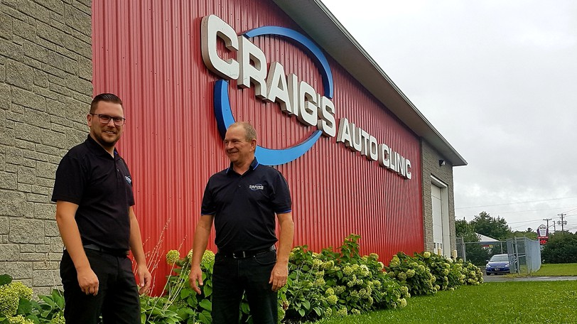 Kyle Clark, left, new owner of Craig's Auto Clinic, is joined by former owner Jack Estey outside the building's location at at 120 Two Nations Crossing. Clark, who recently purchased the automotive repair and auto maintenance service shop, said he would be keeping the company name.