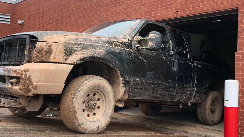 A Ford pickup truck that was reported stolen from a residence in Riverview Sunday was found Monday night, stuck on a muddy trail in Lower Coverdale. The truck is seen being removed from the RCMP detachment building in Riverview Tuesday after being processed by forensics identification officers.