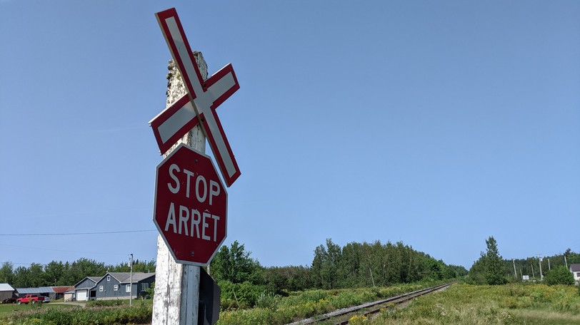 A train crossing along Route 126 northwest of Moncton. A CN train with 30 cars derailed in the area on Saturday.